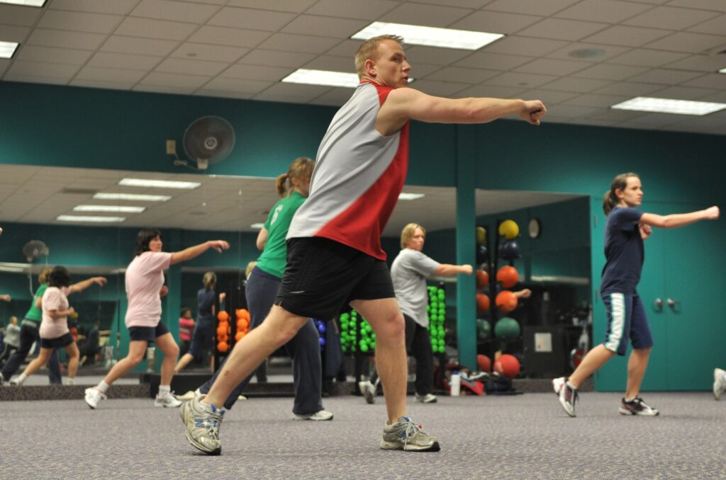 Fitness instructor leading workout class